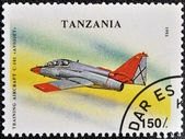 "A stamp printed in Tanzania shows training aircraft C-101 ""Aviojet"" — Foto Stock"
