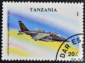 "A stamp printed in Tanzania shows Low - Flying, attack aircraft ""alfa jet"" — Stock Photo"