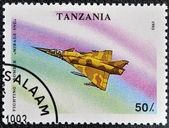 """штамп напечатан в танзании показывает бои бомбардировщик «мираж 3ng"""" — Стоковое фото"""