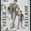 A stamp printed in Belgium shows a picture of a father taking his son to school, commemorating the centenary of Charles Buls — Stock Photo