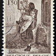 A stamp printed in Belgium shows a engraved with two girls taking a letter to the mailbox post — Stock Photo