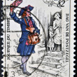 Stock Photo: Stamp printed in Belgium shows drawing of old postman