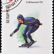 A stamp printed in Belarus shows a a speed skater at the Olympics in Lillehammer in 1994 — Stock Photo