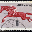 Stock Photo: Stamp printed in Bulgaridedicated to equestrisport, shows jumping