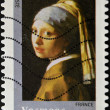 Stamp printed in France shows  Girl With a Pearl Earring by Johannes Vermeer — Stock Photo