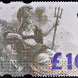 Stock Photo: Stamp printed in Great Britain dedicated to High Value Definitive shows Britannia, personification of England