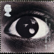 Stock Photo: A stamp printed in Great Britain shows image of an eye and commemorates the Year of the Artist