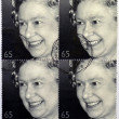 A stamp printed in Great Britain shows shows Queen Elizabeth II - Stock Photo