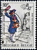 A stamp printed in Belgium shows a drawing of an old postman — Stock Photo