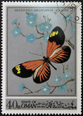 Stamp printed in Oman, shows a Butterfly, Heliconius Melpomene-aglaope — Stock Photo