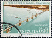 A stamp printed in Venezuela shows inauguration of the bridge over Lake Maracaibo — Stock Photo