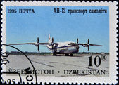 A stamp printed in Uzbekistan shows plane AH-12 — Stock Photo