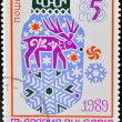 BULGARIA - CIRCA 1988: a stamp printed in Bulgaria shows a drawing with Christmas and a reindeer, circa 1988 - Stock Photo