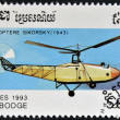 CAMBODIA - CIRCA 1993: A stamp printed in Cambodia shows Sikorsky helicopter (1943), circa 1993 - Stock Photo