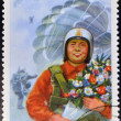 NORTH KOREA - CIRCA 1975: A stamp printed in North Korea shows skydiver with bouquet of flowers, circa 1975 - Stock Photo