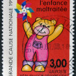 FRANCE - CIRCA 1997: postage stamp printed in Franc eshows a teddy bear, commemorating the protection of abused children, circa 1997. — Stock Photo