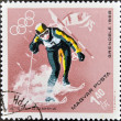 HUNGARY - CIRCA 1968: A stamps printed in Hungary showingan athlete skiing, Winter Olympic sports in Grenoble 1968, circa 1968 - Stock Photo