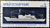 BULGARIA - CIRCA 1962: a stamp printed in Bulgaria shows a drawing of a fishing boat at sea, circa 1962 — Stock Photo