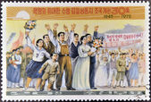 NORTH KOREA - CIRCA 1975: A stamp printed in Korea shows celebrating the anniversary of the founding of North Korea in 1945, circa 1975 — Stock Photo