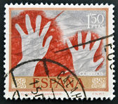 SPAIN-CIRCA 1967: A stamp printed in Spain shows a cave painting of two hands in the negative, the castle cave, Santander, circa 1967. — Stock fotografie