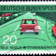 GERMANY - CIRCA 1971: A stamp printed in the Federal Republic of Germany shows car with flashing rear after overtaking, circa 1971 - ストック写真