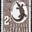AUSTRALIA - CIRCA 1948: A stamp printed in Australia shows a Crocodile with the inscription Aboriginal Art, circa 1948 - ストック写真