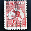 AUSTRALIA - CIRCA 1913: stamp printed in Australia shows kangaroo in the map, one penny, circa 1913 - 