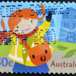 AUSTRALIA - CIRCA 2006: A stamp printed in Australia shows image of a female postal worker, series, circa 2006 - ストック写真