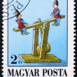 HUNGARY - CIRCA 1988: stamp printed in Hungary shows Seesaw, Antique Toy, circa 1988 - ストック写真