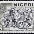 NIGERIA - CIRCA 1946: A stamp printed in Nigeria shows image of Bornu horsemen, circa 1946 - ストック写真