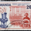 RWANDA - CIRCA 1976: A stamp printed in Rwanda dedicated to first telephone link, circa 1976 - ストック写真