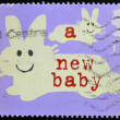 UNITED KINGDOM - CIRCA 2002: A stamp printed in Great Britain shows Rabbits ( a new baby), circa 2002 - ストック写真