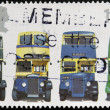 Постер, плакат: UNITED KINGDOM CIRCA 2001: A stamp printed in Great Britain shows AEC Regent 1 Daimler COG5 Utility Guy Arab Mk II and AEC Regent III RT Type circa 2001