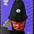 Stock Photo: UNITED KINGDOM - CIRC2001: stamp printed in Great Britain dedicated to Punch and Judy shows policeman, circ2001