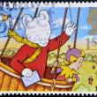 UNITED KINGDOM - CIRCA 1994: A stamp printed in Great Britain shows Rupert Bear in hot air balloon, circa 1994 — Stock Photo