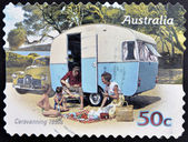 AUSTRALIA - CIRCA 2007: A stamp printed in australia shows Family enjoying a caravan of the 50s, caravanning 1950s, circa 2007 — Stock Photo