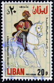 """LEBANON - CIRCA 1973: A stamp printed in Lebanon from the """"Ancient costumes"""" issue shows a man on horseback, circa 1973. — Foto de Stock"""