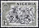 NIGERIA - CIRCA 1946: A stamp printed in Nigeria shows image of Bornu horsemen, circa 1946 — Stock Photo