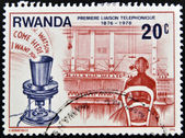 RWANDA - CIRCA 1976: A stamp printed in Rwanda dedicated to first telephone link, circa 1976 — Stockfoto