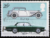 UNITED KINGDOM - CIRCA 1982: Stamp printed in Great Britain showing the Jaguar motor vehicle model SS1 and XJ6 to commemorate the British Motor Industry, circa 1982. — Stock Photo