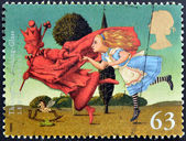 UNITED KINGDOM - CIRCA 1988: A stamp printed in Great Britain shows Through The Looking Glass (Lewis Carroll), circa 1988 — Stock Photo