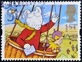联合王国-大约 1994年: 在英国打印戳记表明,鲁珀特熊在热空气的气球,大约在 1994年 — 图库照片