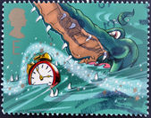 UNITED KINGDOM - CIRCA 2002: A stamp printed in Great Britain shows Crocodile and Alarm Clock. Stamp dedicated to Peter Pan, circa 2002 — Stock Photo