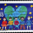 UNITED STATES OF AMERICA - CIRCA 2000: A stamp printed in USA shows drawing by Sarah Lipsey reflecting children of all race holding hands before a heart with earth, circa 2000 — Stock Photo