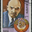 KAMPUCHEA - CIRCA 1985: A stamp printed in Cambodia, Lenin's portrait and coat of arms of the Soviet Union, circa 1985 - Photo