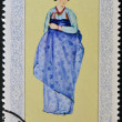NORTH KOREA - CIRCA 1977: A stamp printed in DPR Korea shows woman in traditional dress, circa 1977 — Stock Photo