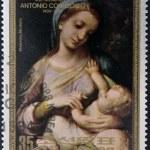 NORTH KOREA - CIRCA 1984: A stamp printed in DPR Korea shows a reproduction of Correggio or Antonio Allegri painting - Madonna, Modena, circa 1984 — Stock Photo