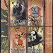 Постер, плакат: DJIBOUTI CIRCA 2009: stamps printed in Djibouti dedicated to the characters of Walt Disney and giant pandas circa 2009