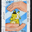 Foto de Stock  : ISLAMIC REPUBLIC OF IRAN - CIRC1987: Stamp printed in Irdedicated to welfare week, circ1987