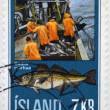 ICELAND - CIRCA 1970: A stamp printed in Iceland shows fishermen and gadus morhua, circa 1970 — Stock Photo
